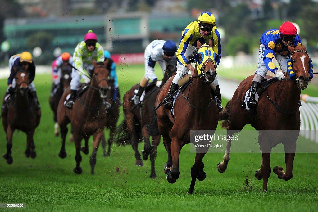Michael Rodd riding Word of Mouth (L) defeats Ibrahim Gundogdu riding Leventi in Race 5, the Rod Johnson Handicap during Melbourne racing at Flemington Racecourse on June 14, 2014 in Melbourne, Australia.