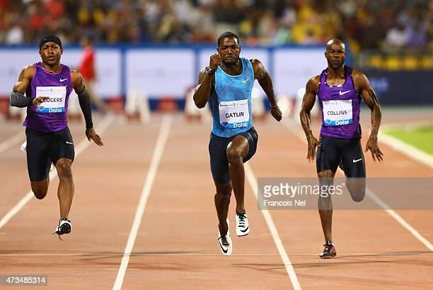 Michael Rodgers of the United States Justin Gatlin of the United States and Kim Collins of St Kitts and Nevis compete in the Men's 100m during the...