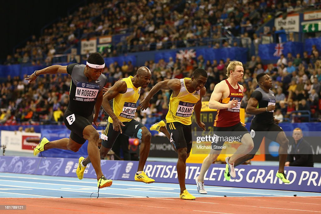 Michael Rodgers (L) of USA wins the men's 60m final from <a gi-track='captionPersonalityLinkClicked' href=/galleries/search?phrase=Kim+Collins+-+Sprinter&family=editorial&specificpeople=171583 ng-click='$event.stopPropagation()'>Kim Collins</a> (2L) during the British Athletics Grand Prix at the National Indoor Arena on February 16, 2013 in Birmingham, England.