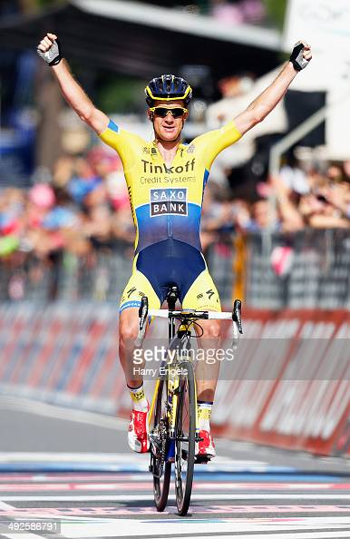 Michael Rogers of Australia and TinkoffSaxo celebrates crossing the finish line to win the eleventh stage of the 2014 Giro d'Italia a 249km medium...