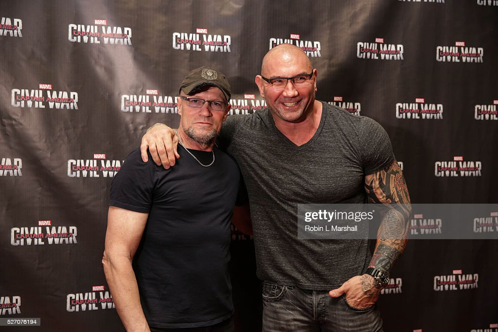 <a gi-track='captionPersonalityLinkClicked' href=/galleries/search?phrase=Michael+Rooker&family=editorial&specificpeople=640228 ng-click='$event.stopPropagation()'>Michael Rooker</a> and <a gi-track='captionPersonalityLinkClicked' href=/galleries/search?phrase=Dave+Bautista&family=editorial&specificpeople=4344445 ng-click='$event.stopPropagation()'>Dave Bautista</a> attend 'Captain America: Civil War' Screening at the Fox Theatre on May 1, 2016 in Atlanta, Georgia.