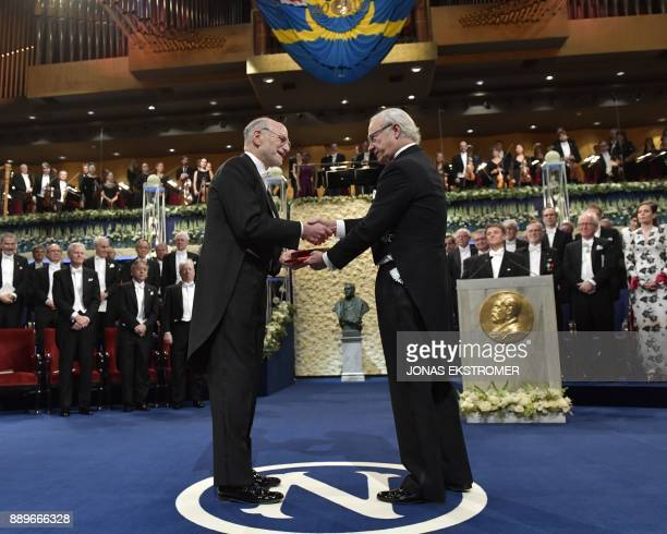 Michael Rosbash laureate in physiology or medicine receives the award from King Carl XVI Gustaf of Sweden during the Nobel Prize Award Ceremony at...