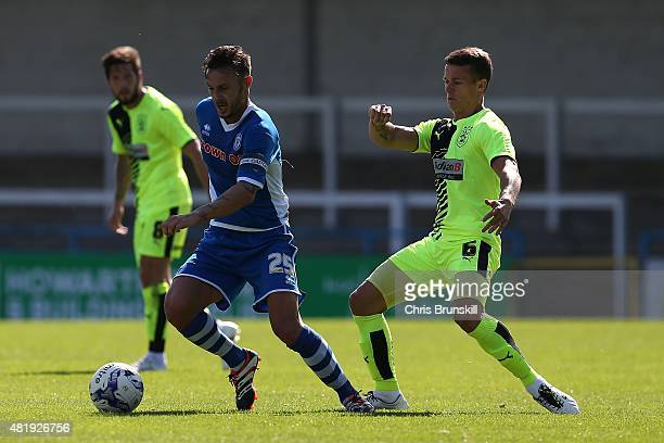 Michael Rose of Rochdale in action with Jon Hogg of Huddersfied Town during the pre season friendly match between Rochdale and Huddersfield Town at...