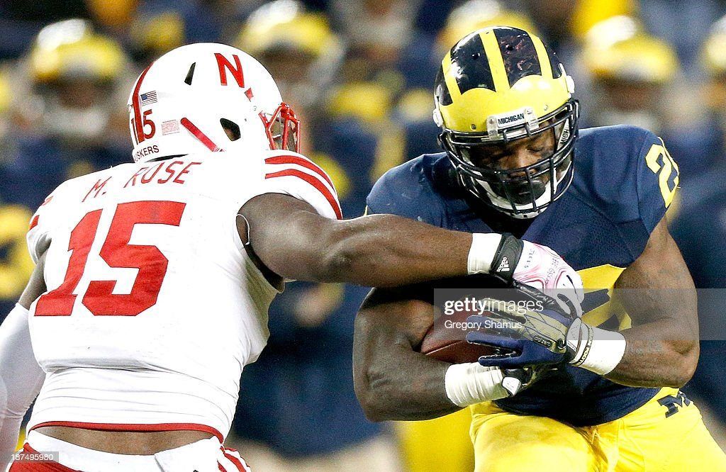 Michael Rose #15 of the Nebraska Cornhuskers tries to arm tackle Fitzgerald Toussaint #28 of the Michigan Wolverines in the third quarter at Michigan Stadium on November 9, 2013 in Ann Arbor, Michigan.