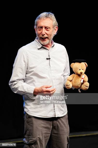 Michael Rosen author of We're Going On a Bear Hunt gives a reading lesson to 1438 children as they break the record for the largest reading lesson in...