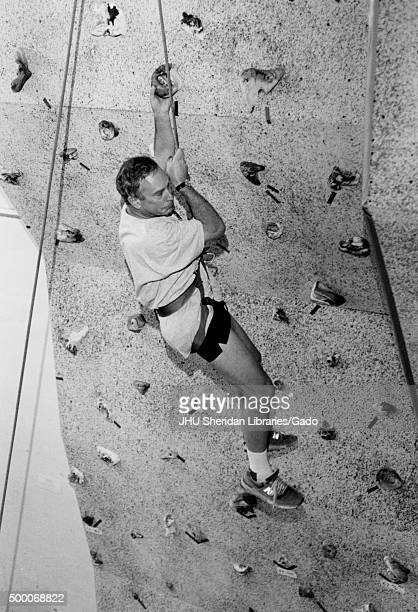 Michael Rubens Bloomberg candid shot Bloomberg is climbing a climbing wall and dangling from the safety harness ca 47 years of age 1997