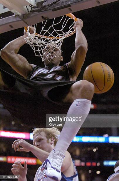 Michael Ruffin of the Utah Jazz dunks during 9382 loss to the Los Angeles Clippers at the Staples Center on Friday Jan 24 2004