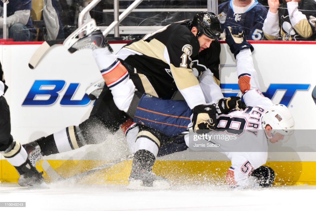 <a gi-track='captionPersonalityLinkClicked' href=/galleries/search?phrase=Michael+Rupp&family=editorial&specificpeople=201634 ng-click='$event.stopPropagation()'>Michael Rupp</a> #17 of the Pittsburgh Penguins finishes a check on Jeff Petry #58 of the Edmonton Oilers on March 13, 2011 at CONSOL Energy Center in Pittsburgh, Pennsylvania.