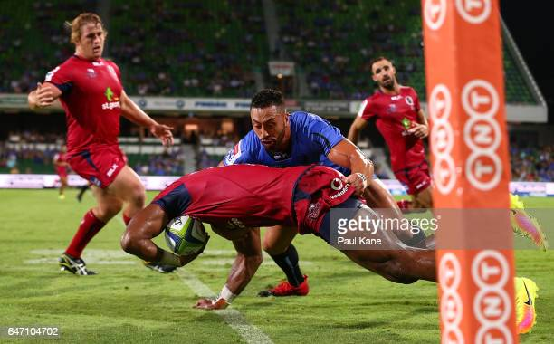 Michael Ruru of the Force tackles Eto Nabuli of the Reds during the round two Super Rugby match between the Western Force and the Reds at nib Stadium...