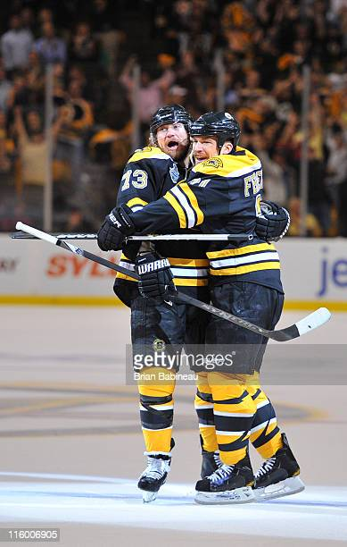 Michael Ryder and Andrew Ference of the Boston Bruins celebrate a goal against the Vancouver Canucks in Game Six of the 2011 NHL Stanley Cup Final at...