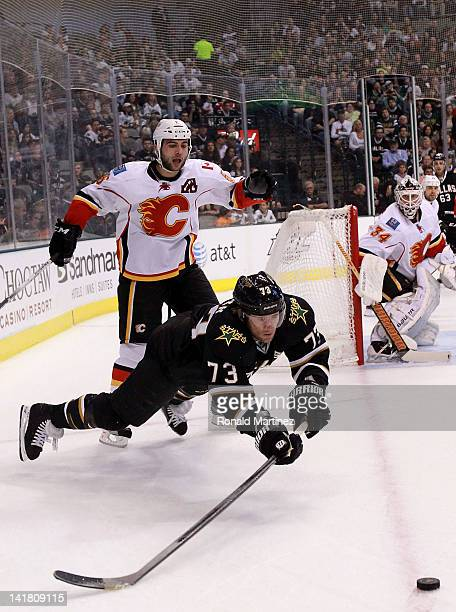 Michael Ryder of the Dallas Stars skates the puck past Mark Giordano of the Calgary Flames at American Airlines Center on March 24 2012 in Dallas...