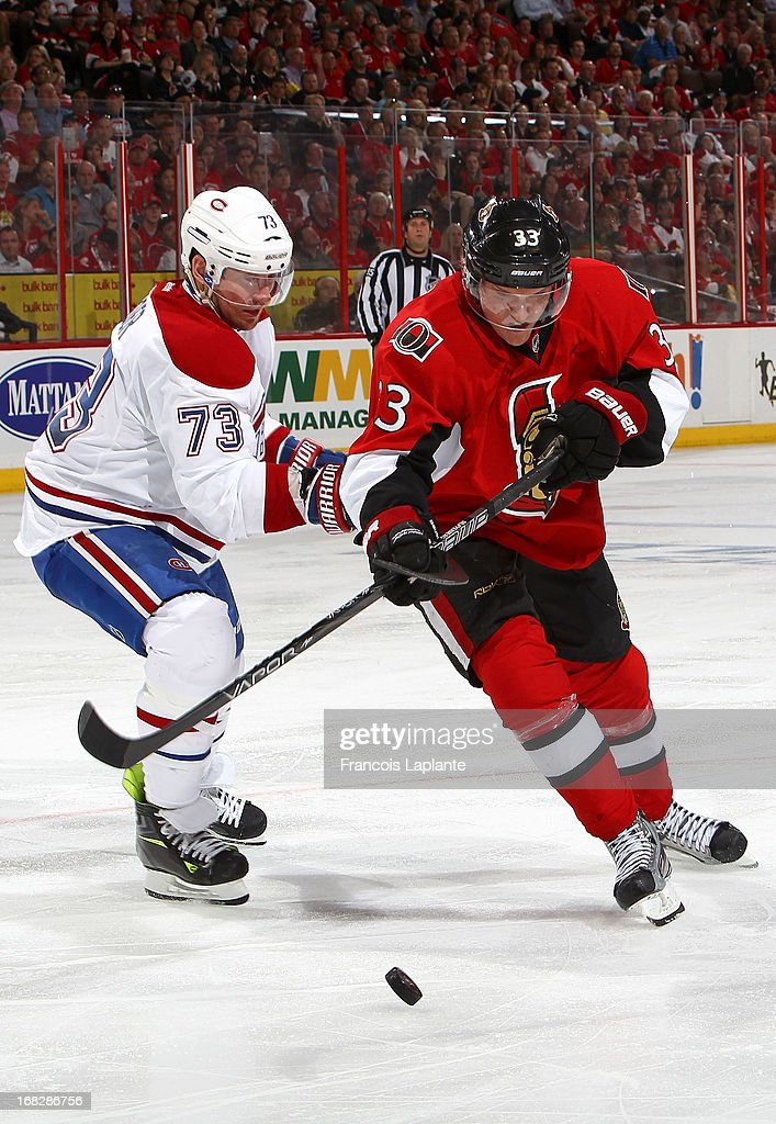 Michael Ryder #73 of the Montreal Canadiens battles for the puck against Jakob Silfverberg #33 of the Ottawa Senators in Game Four of the Eastern Conference Quarterfinals during the 2013 NHL Stanley Cup Playoffs at Scotiabank Place on May 7, 2013 in Ottawa, Ontario, Canada.
