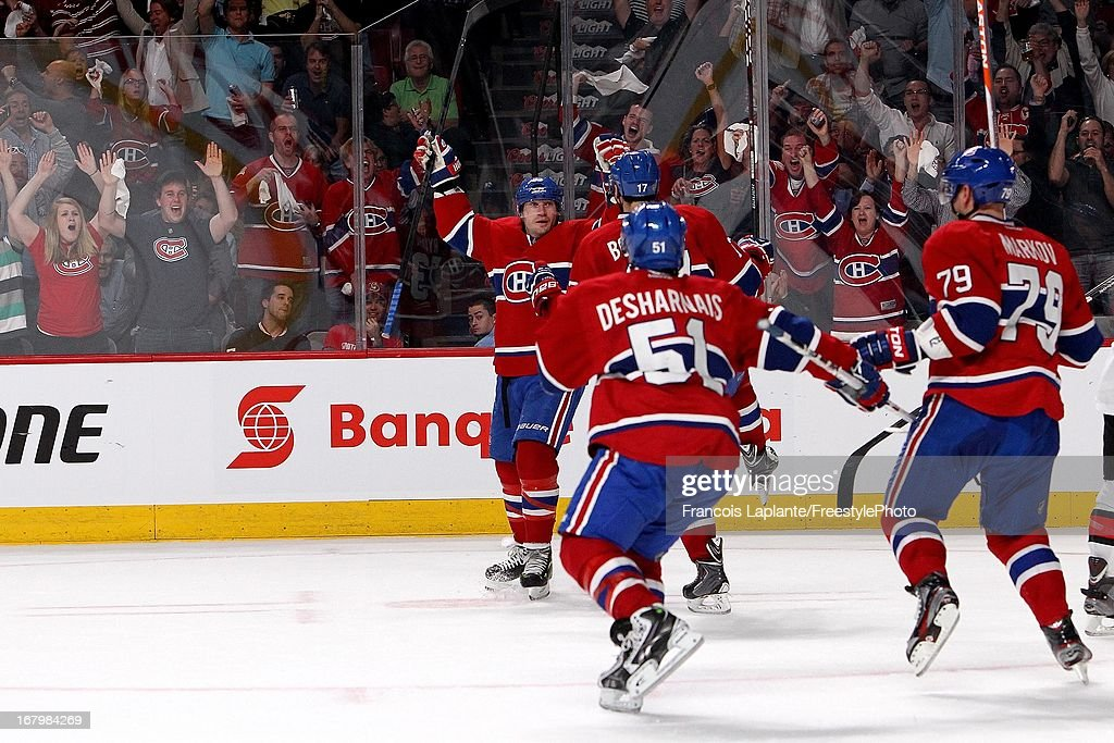 <a gi-track='captionPersonalityLinkClicked' href=/galleries/search?phrase=Michael+Ryder&family=editorial&specificpeople=208983 ng-click='$event.stopPropagation()'>Michael Ryder</a> #73 of the Montreal Canadiens celebrates his second period goal with teammates <a gi-track='captionPersonalityLinkClicked' href=/galleries/search?phrase=Rene+Bourque&family=editorial&specificpeople=685715 ng-click='$event.stopPropagation()'>Rene Bourque</a> #17, <a gi-track='captionPersonalityLinkClicked' href=/galleries/search?phrase=Andrei+Markov&family=editorial&specificpeople=204528 ng-click='$event.stopPropagation()'>Andrei Markov</a> #79 and <a gi-track='captionPersonalityLinkClicked' href=/galleries/search?phrase=David+Desharnais&family=editorial&specificpeople=4084305 ng-click='$event.stopPropagation()'>David Desharnais</a> #51 against the Ottawa Senators in Game Two of the Eastern Conference Quarterfinals during the 2013 NHL Stanley Cup Playoffs at the Bell Centre on May 3, 2013 in Montreal, Quebec, Canada.