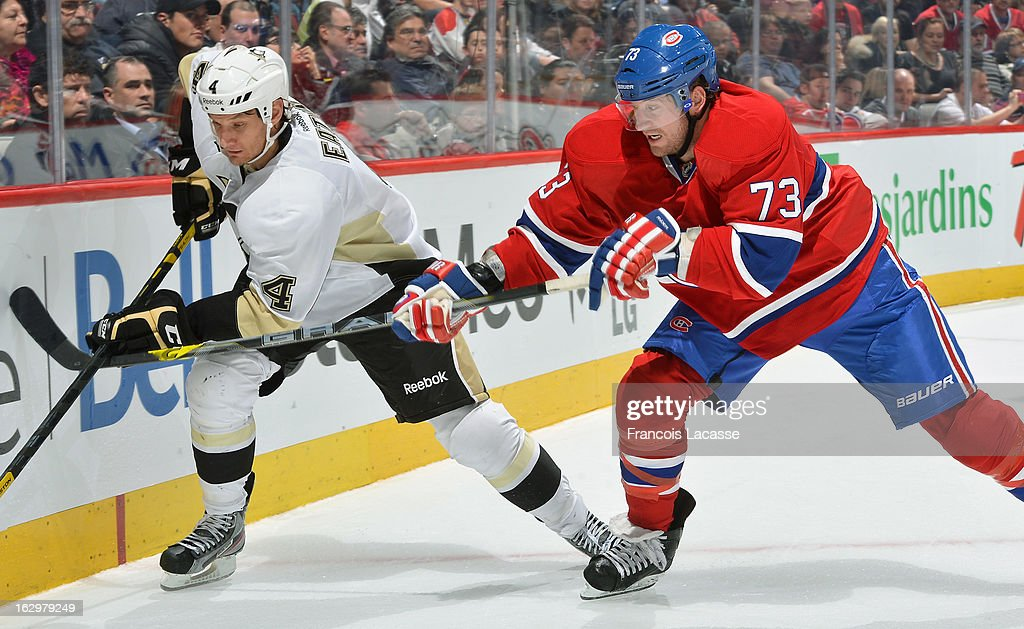 Michael Ryder #73 of the Montreal Canadiens chases after the puck with Mark Eaton #4 of the Pittsburgh Penguins during the NHL game on March 2, 2013 at the Bell Centre in Montreal, Quebec, Canada.