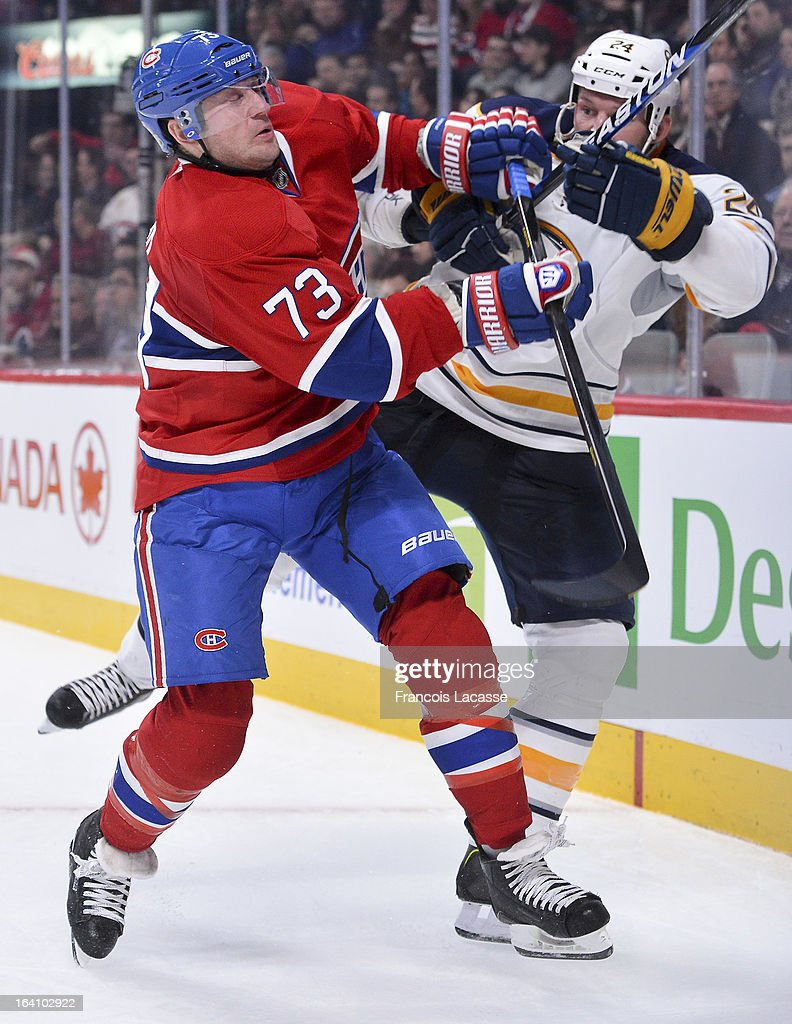 <a gi-track='captionPersonalityLinkClicked' href=/galleries/search?phrase=Michael+Ryder&family=editorial&specificpeople=208983 ng-click='$event.stopPropagation()'>Michael Ryder</a> #73 of the Montreal Canadiens collides with <a gi-track='captionPersonalityLinkClicked' href=/galleries/search?phrase=Robyn+Regehr&family=editorial&specificpeople=171828 ng-click='$event.stopPropagation()'>Robyn Regehr</a> #24 of the Buffalo Sabres during the NHL game on March 19, 2013 at the Bell Centre in Montreal, Quebec, Canada.