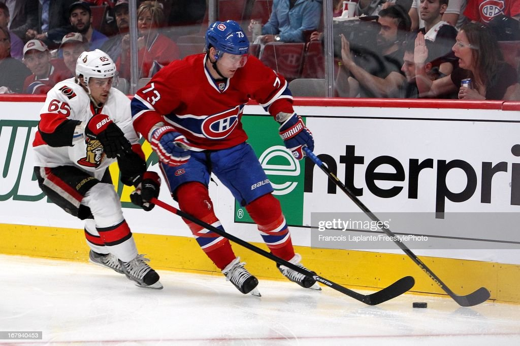 <a gi-track='captionPersonalityLinkClicked' href=/galleries/search?phrase=Michael+Ryder&family=editorial&specificpeople=208983 ng-click='$event.stopPropagation()'>Michael Ryder</a> #73 of the Montreal Canadiens controls the puck against <a gi-track='captionPersonalityLinkClicked' href=/galleries/search?phrase=Erik+Karlsson&family=editorial&specificpeople=5370939 ng-click='$event.stopPropagation()'>Erik Karlsson</a> #65 of the Ottawa Senators in Game One of the Eastern Conference Quarterfinal during the 2013 NHL Stanley Cup Playoffs at the Bell Centre on May 2, 2013 in Montreal, Quebec, Canada.
