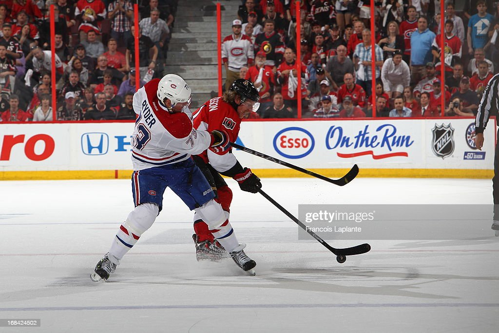Michael Ryder #73 of the Montreal Canadiens goes for the puck against Daniel Alfredsson #11 of the Ottawa Senators in Game Four of the Eastern Conference Quarterfinals during the 2013 NHL Stanley Cup Playoffs at Scotiabank Place on May 7, 2013 in Ottawa, Ontario, Canada.