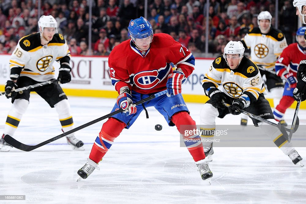 <a gi-track='captionPersonalityLinkClicked' href=/galleries/search?phrase=Michael+Ryder&family=editorial&specificpeople=208983 ng-click='$event.stopPropagation()'>Michael Ryder</a> #73 of the Montreal Canadiens loses the puck while being chased by <a gi-track='captionPersonalityLinkClicked' href=/galleries/search?phrase=Brad+Marchand&family=editorial&specificpeople=2282544 ng-click='$event.stopPropagation()'>Brad Marchand</a> #63 of the Boston Bruins during the NHL game at the Bell Centre on April 6, 2013 in Montreal, Quebec, Canada.