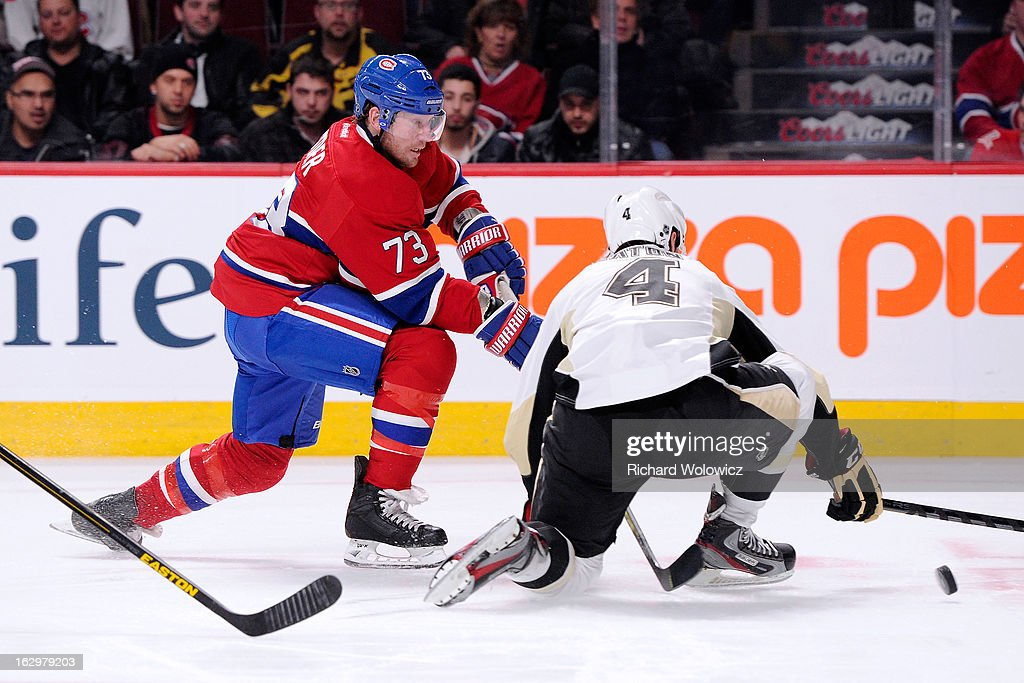 Michael Ryder #73 of the Montreal Canadiens passes the puck in front of Mark Eaton #4 of the Pittsburgh Penguins during the NHL game at the Bell Centre on March 2, 2013 in Montreal, Quebec, Canada.