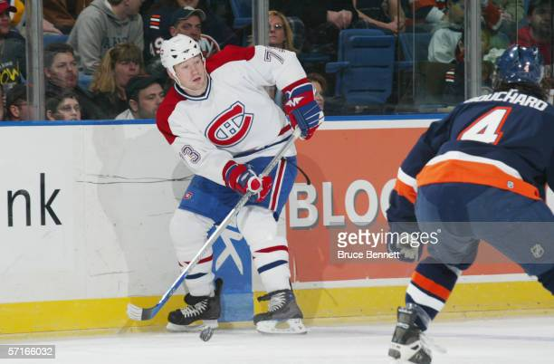 Michael Ryder of the Montreal Canadiens plays the puck as Joel Bouchard of the New York Islanders defends during their NHL game on February 28 2006...