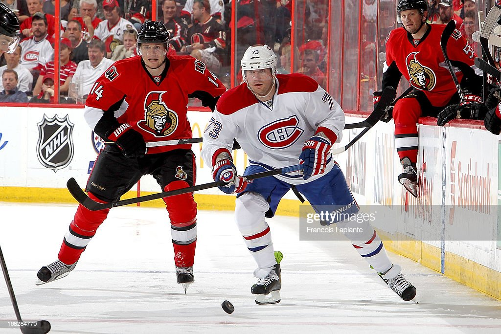 Michael Ryder #73 of the Montreal Canadiens skates with the puck against Chris Phillips #4 of the Ottawa Senators in Game Three of the Eastern Conference Quarterfinals during the 2013 NHL Stanley Cup Playoffs at Scotiabank Place on May 5, 2013 in Ottawa, Ontario, Canada.