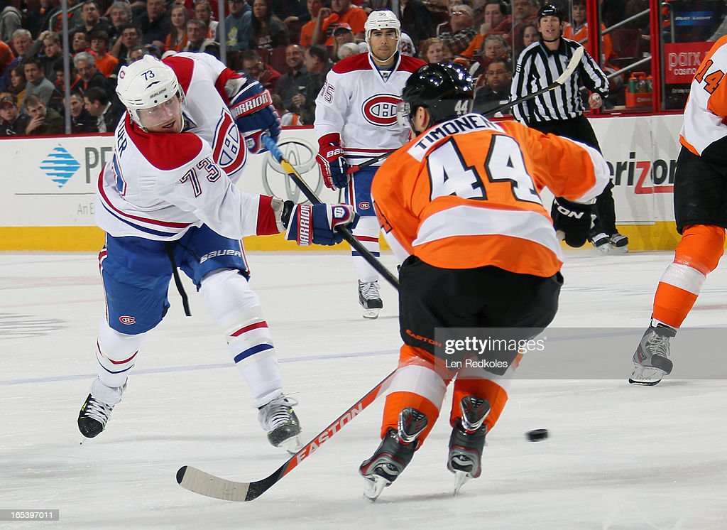 <a gi-track='captionPersonalityLinkClicked' href=/galleries/search?phrase=Michael+Ryder&family=editorial&specificpeople=208983 ng-click='$event.stopPropagation()'>Michael Ryder</a> #73 of the Montreal Canadiens takes a shot on goal while being defended by <a gi-track='captionPersonalityLinkClicked' href=/galleries/search?phrase=Kimmo+Timonen&family=editorial&specificpeople=201521 ng-click='$event.stopPropagation()'>Kimmo Timonen</a> #44 of the Philadelphia Flyers on April 3, 2013 at the Wells Fargo Center in Philadelphia, Pennsylvania.