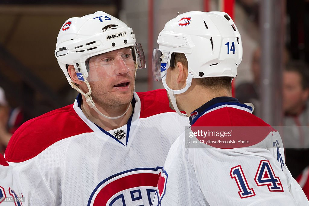 Michael Ryder #73 of the Montreal Canadiens talks to team mate Tomas Plekanec #14 in Game Three of the Eastern Conference Quarterfinals against the Ottawa Senators, during the 2013 NHL Stanley Cup Playoffs at Scotiabank Place, on May 5, 2013 in Ottawa, Ontario, Canada.