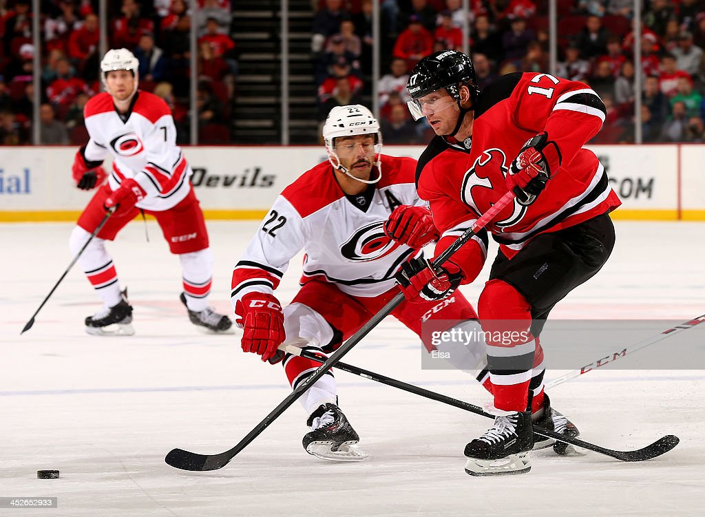 <a gi-track='captionPersonalityLinkClicked' href=/galleries/search?phrase=Michael+Ryder&family=editorial&specificpeople=208983 ng-click='$event.stopPropagation()'>Michael Ryder</a> #17 of the New Jersey Devils passes the puck as <a gi-track='captionPersonalityLinkClicked' href=/galleries/search?phrase=Manny+Malhotra&family=editorial&specificpeople=204479 ng-click='$event.stopPropagation()'>Manny Malhotra</a> #22 of the Carolina Hurricanes defends at Prudential Center on November 27, 2013 in Newark, New Jersey.