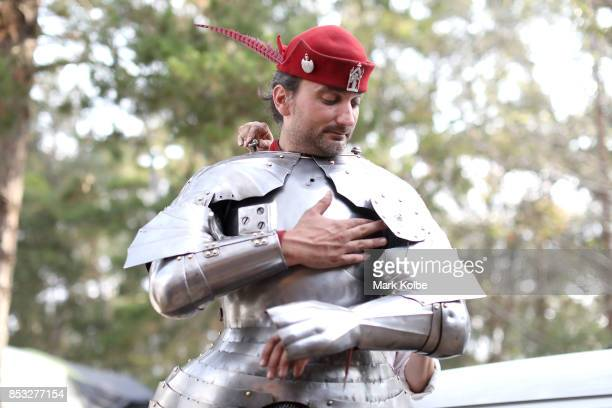 SYDNEY AUSTRALIA SEPTEMBER Michael Sadde of France is helped into his armour as he prepares to compete in the World Jousting Championships on...