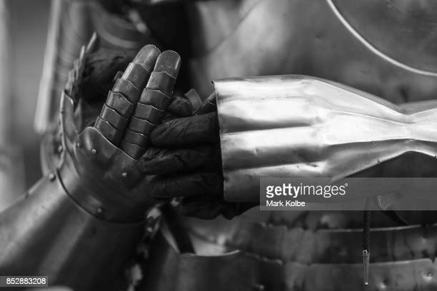 Michael Sadde of France puts on his gloves as he prepares to compete in the World Jousting Championships on September 24 2017 in Sydney Australia The...