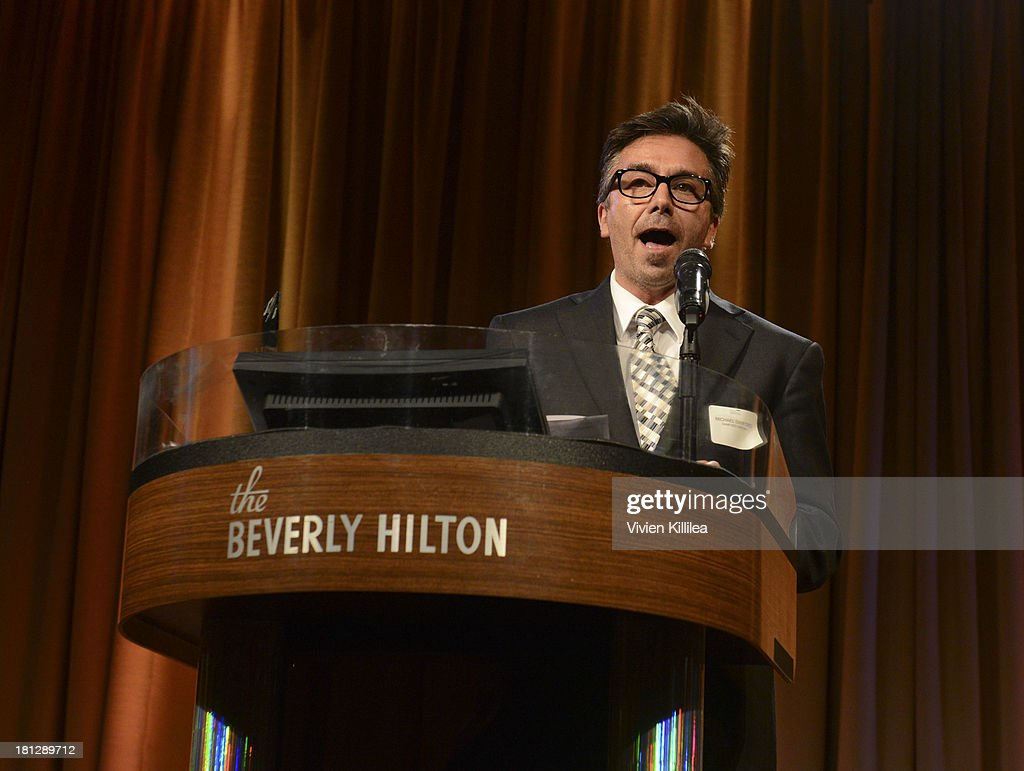 Michael Sanford receives the award for Commercial Casting Director of the Year at the 12th Annual Heller Awards at The Beverly Hilton Hotel on September 19, 2013 in Beverly Hills, California.
