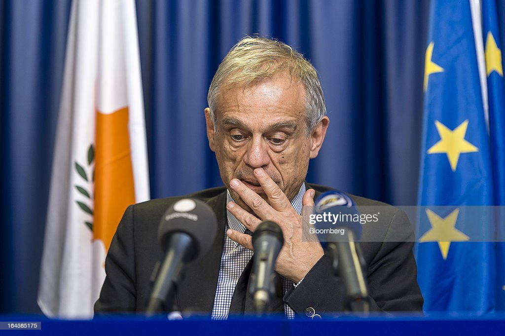 Michael Sarris, Cyprus's finance minister, speaks during a news conference following the Eurogroup meeting in Brussels, Belgium, on Monday, March 25, 2013. Cyprus dodged a disorderly default and unprecedented exit from the euro currency by bowing to demands to shrink its banking system in exchange for a 10 billion-euro ($13 billion) bailout. Photographer: Jock Fistick/Bloomberg via Getty Images