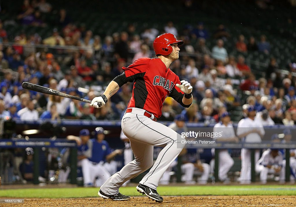 Michael Saunders #20 of Canada hits a two RBI single against Italy during seventh inning of the World Baseball Classic First Round Group D game at Chase Field on March 8, 2013 in Phoenix, Arizona.