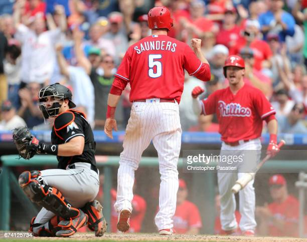 Michael Saunders of the Philadelphia Phillies reacts after scoring what would be the game winning run in the bottom to the sixth inning against the...
