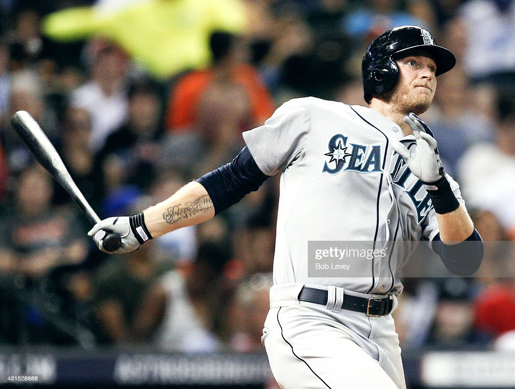 Michael Saunders #55 of the Seattle Mariners hits a home run in the fourth inning against the Houston Astros at Minute Maid Park on June 30, 2014 in Houston, Texas.