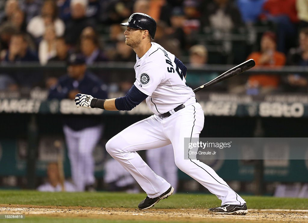 Michael Saunders #55 of the Seattle Mariners hits a two-run double in the fourth inning against the Los Angeles Angels of Anaheim at Safeco Field on October 2, 2012 in Seattle, Washington.