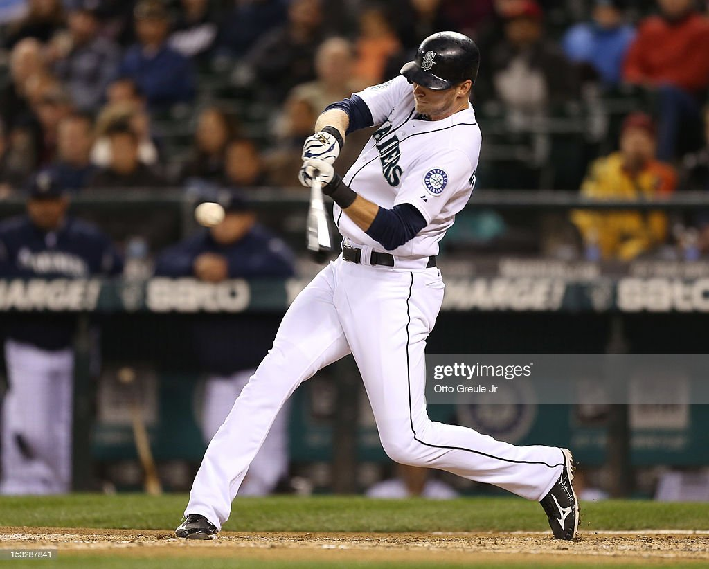 Michael Saunders #55 of the Seattle Mariners hits an RBI double in the sixth inning against the Los Angeles Angels of Anaheim at Safeco Field on October 2, 2012 in Seattle, Washington.