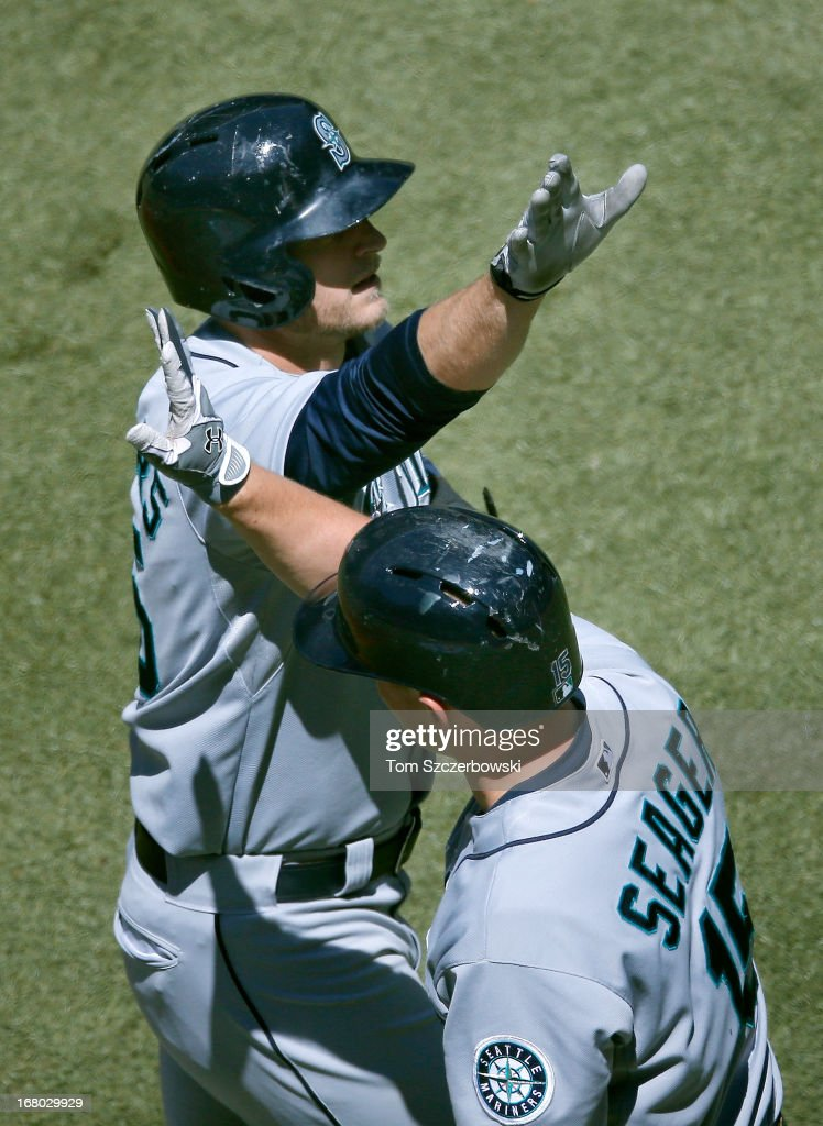 Michael Saunders #55 of the Seattle Mariners is congratulated by <a gi-track='captionPersonalityLinkClicked' href=/galleries/search?phrase=Kyle+Seager&family=editorial&specificpeople=7682389 ng-click='$event.stopPropagation()'>Kyle Seager</a> #15 after hitting a solo home run in the first inning during MLB game action against the Toronto Blue Jays on May 4, 2013 at Rogers Centre in Toronto, Ontario, Canada.