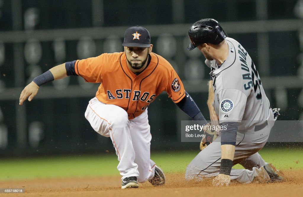Michael Saunders of the Seattle Mariners is tagged out by Marwin Gonzalez of the Houston Astros in the seventh inning at Minute Maid Park on...