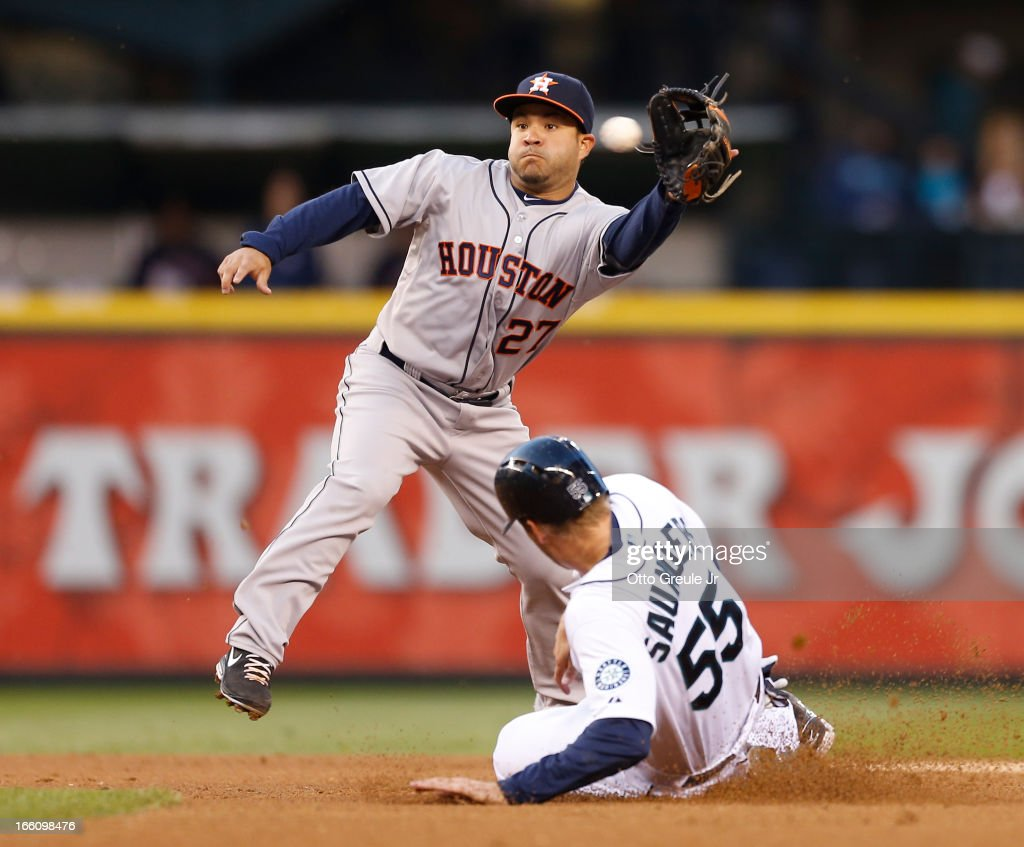 Michael Saunders #55 of the Seattle Mariners steals second base in the first inning against <a gi-track='captionPersonalityLinkClicked' href=/galleries/search?phrase=Jose+Altuve&family=editorial&specificpeople=7934195 ng-click='$event.stopPropagation()'>Jose Altuve</a> #27 of the Houston Astros on Opening Day at Safeco Field on April 8, 2013 in Seattle, Washington.