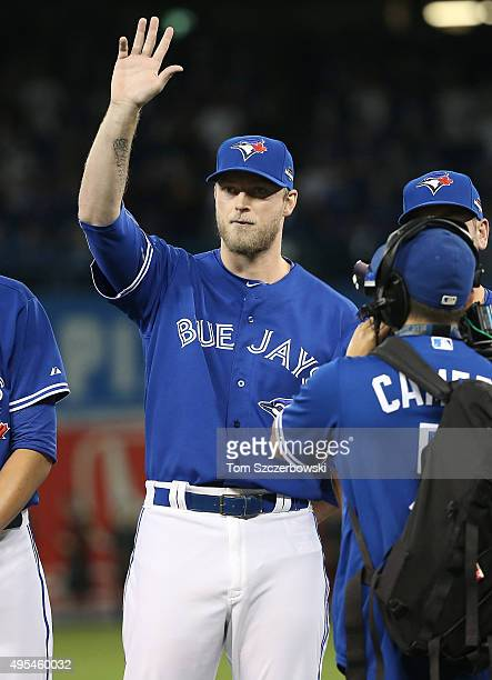 Michael Saunders of the Toronto Blue Jays acknowledges the crowd as he is introduced before the start of the game against the Kansas City Royals...