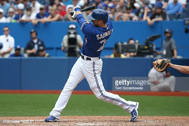 Michael Saunders of the Toronto Blue Jays bats during MLB game action against the Boston Red Sox on May 9 2015 at Rogers Centre in Toronto Ontario...