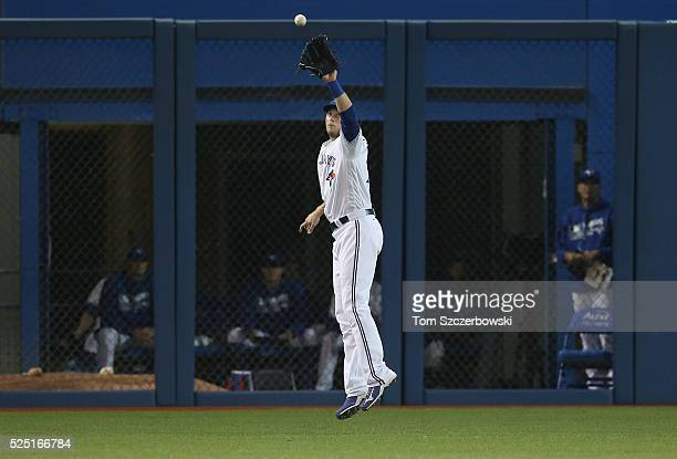 Michael Saunders of the Toronto Blue Jays catches a high line drive hit to left field in the fifth inning during MLB game action against the Chicago...