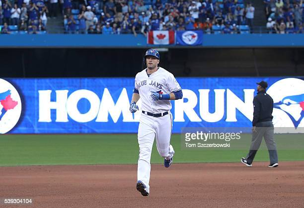 Michael Saunders of the Toronto Blue Jays circles the bases after hitting a solo home run in the fourth inning during MLB game action against the...
