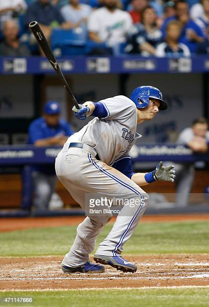 Michael Saunders of the Toronto Blue Jays grounds out to first base to end the top of the fourth inning against the Tampa Bay Rays on April 25 2015...
