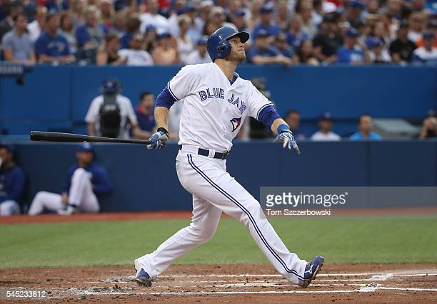 Michael Saunders of the Toronto Blue Jays hits a solo home run in the fourth inning during MLB game action against the Kansas City Royals on July 6...