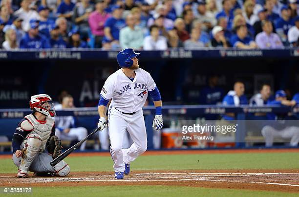 Michael Saunders of the Toronto Blue Jays hits a solo home run in the bottom of the second inning of ALCS Game 3 against the Cleveland Indians at the...
