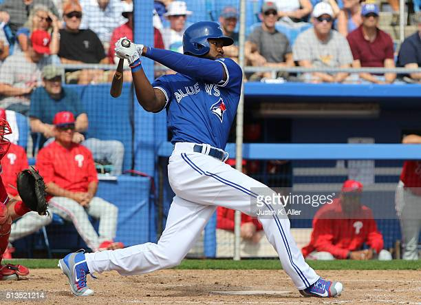 Michael Saunders of the Toronto Blue Jays in action during the game against the Philadelphia Phillies at Florida Auto Exchange Stadium on March 2...