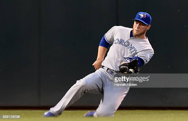 Michael Saunders of the Toronto Blue Jays makes a catch in left field of the ball hit by Jorge Polanco of the Minnesota Twins during the fourth...