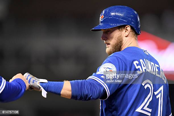 Michael Saunders of the Toronto Blue Jays reacts after hitting a single in the second inning against Corey Kluber of the Cleveland Indians during...